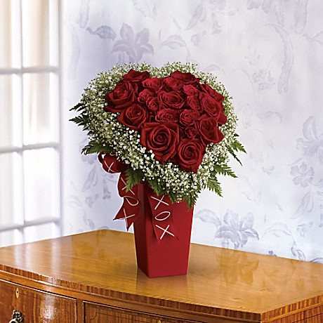 Heart & Soul bouquet - Red roses and white Million Star gypsophila accented with fern are delivered in a red vase decorated with a satin ribbon.