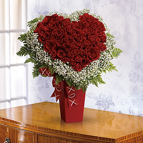Heart and Soul bouquet  with red roses. We also offer an affordable option with red carnations.