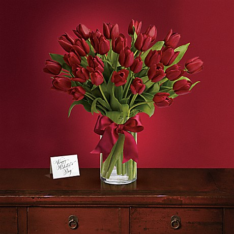 Click to buy this bouquet: Radiantly Red Tulips
