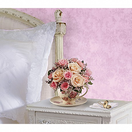 Teleflora's Victorian Teacup Bouquet to show sympathy to a grieving person