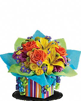 Teleflora's Rainbow Present Flower Arrangement