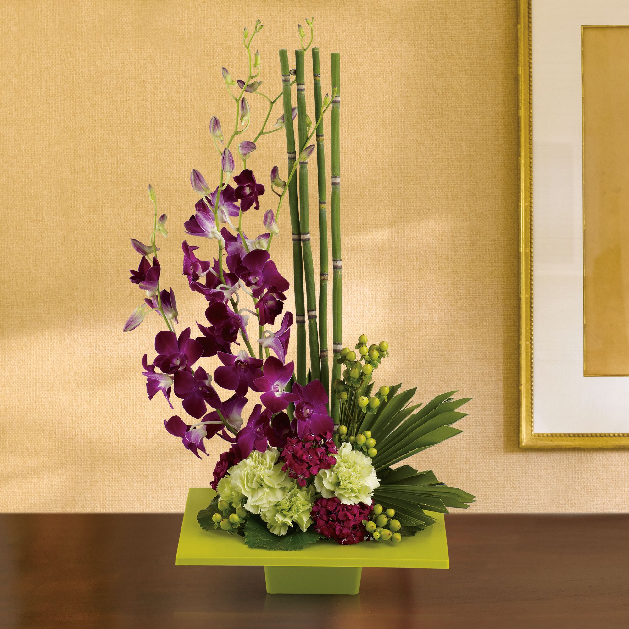 Zen Artistry - striking bouquet surprises with delicate purple orchids, mini bamboo and a colorful mix of blooms - sure to improve any room's feng shui.