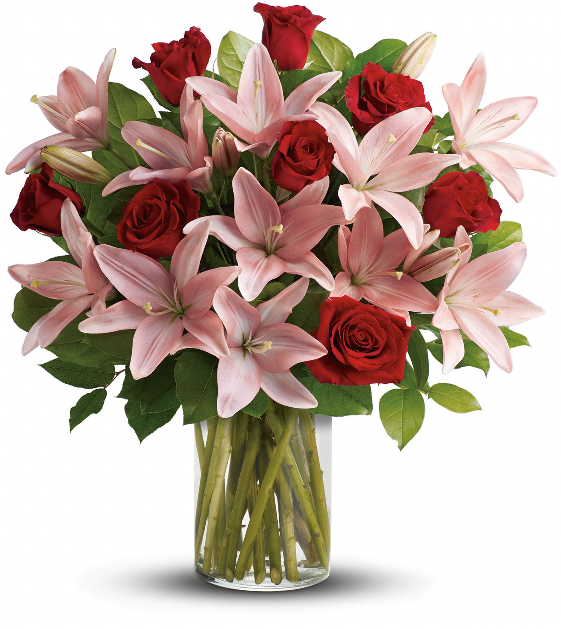 So Enchanting Bouquet - includes red roses, pink lilies and fresh lemon leaves.
